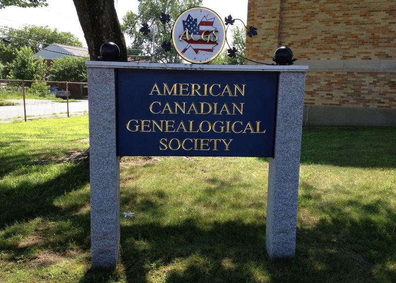 Granite-posted sign with blue wood and gold lettering for the American Canadian Genealogical Society