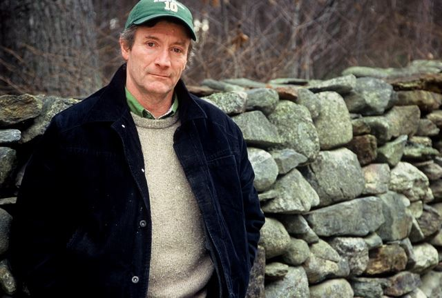 Photo of Kevin Gardner leaning against a stone wall