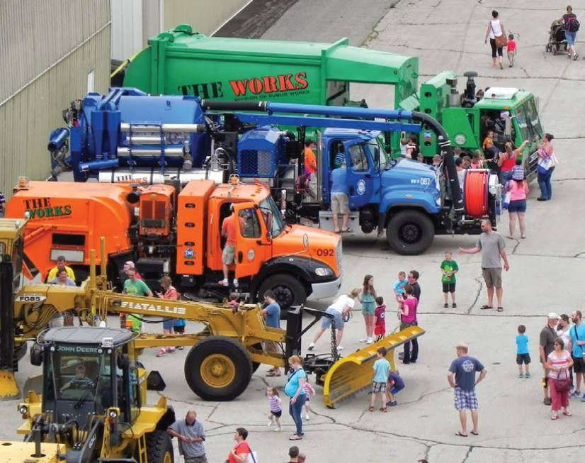 Photo of DPW trucks and equipment on concrete at the airport