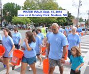 Photo of participants wearing event shirts and carrying orange buckets, event name and info in blue