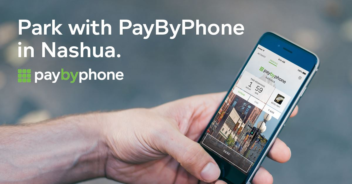 User holding a phone with the Nashua Pay By Phone app displayed on the screen
