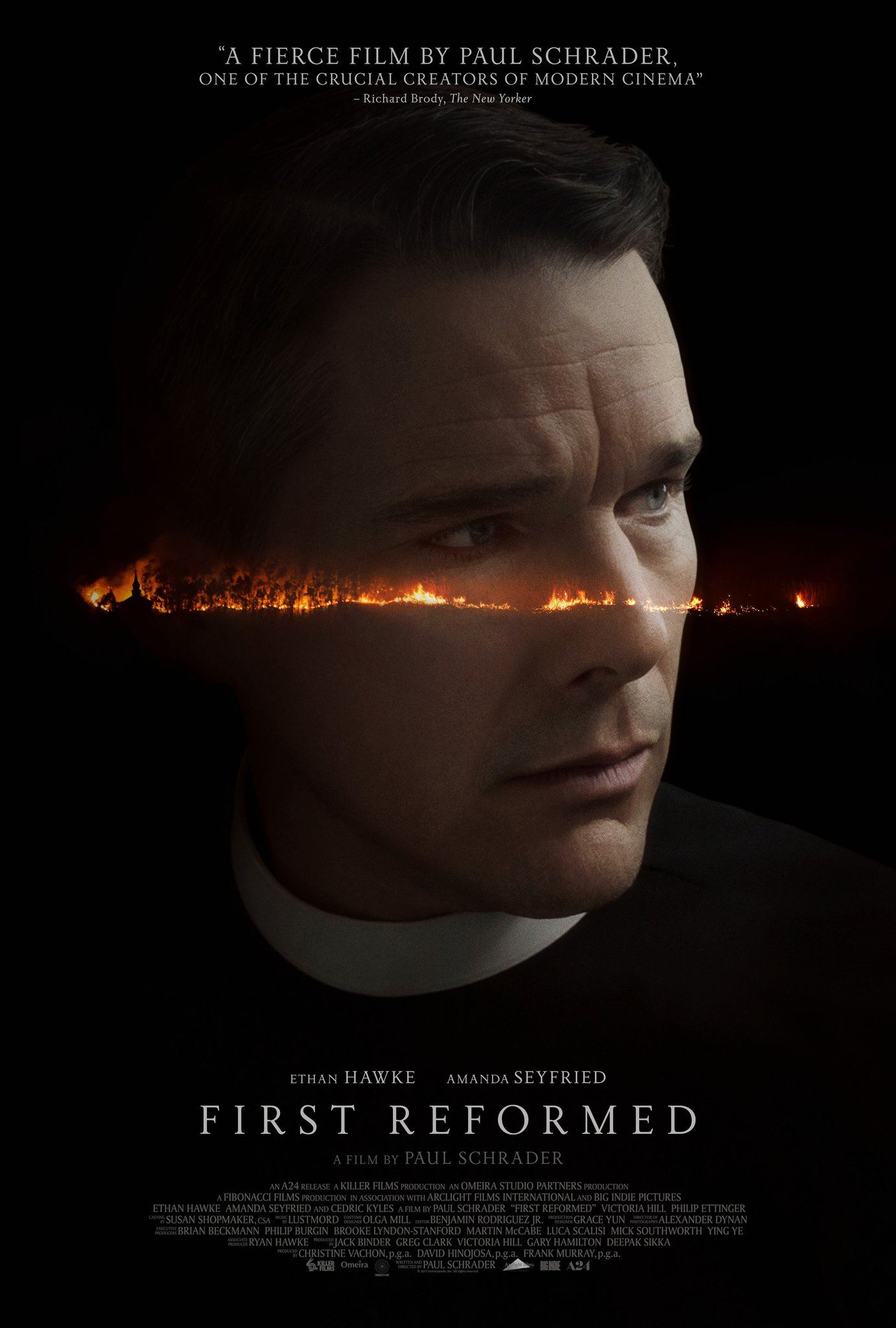 Movie Poster featuring close up image of priest with line of fire running across face. Black backgro