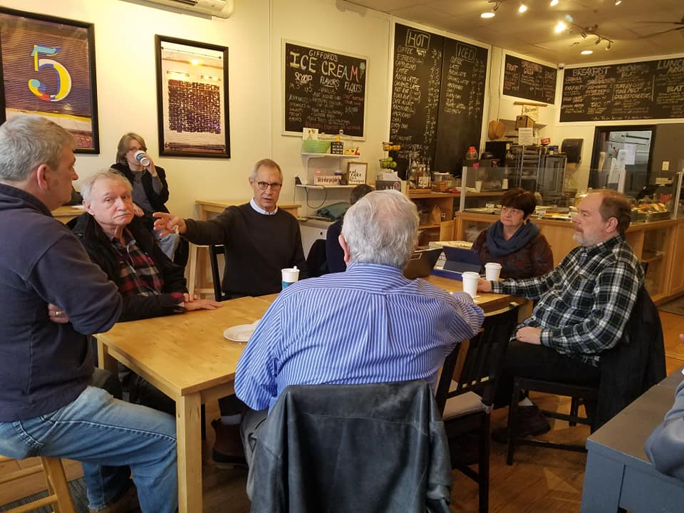 Image of the Mayor speaking with residents in a coffee shop