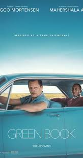 Movie poster with teal background, characters riding in a teal car