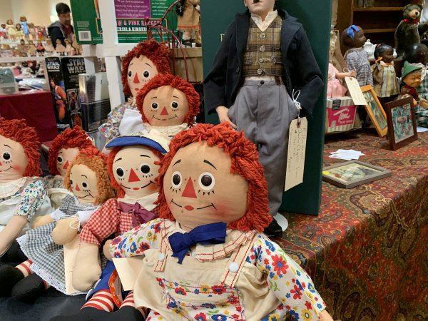 Image of Raggedy Ann dolls and other toys at previous event
