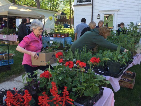 Image of volunteers and customers at a previous plant sale