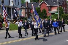 Image of veterans marching in a previous parade