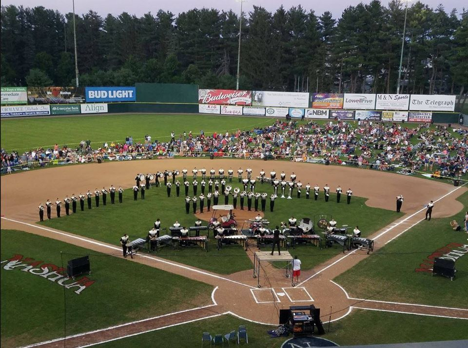 Photo of band and fans at Holman Stadium