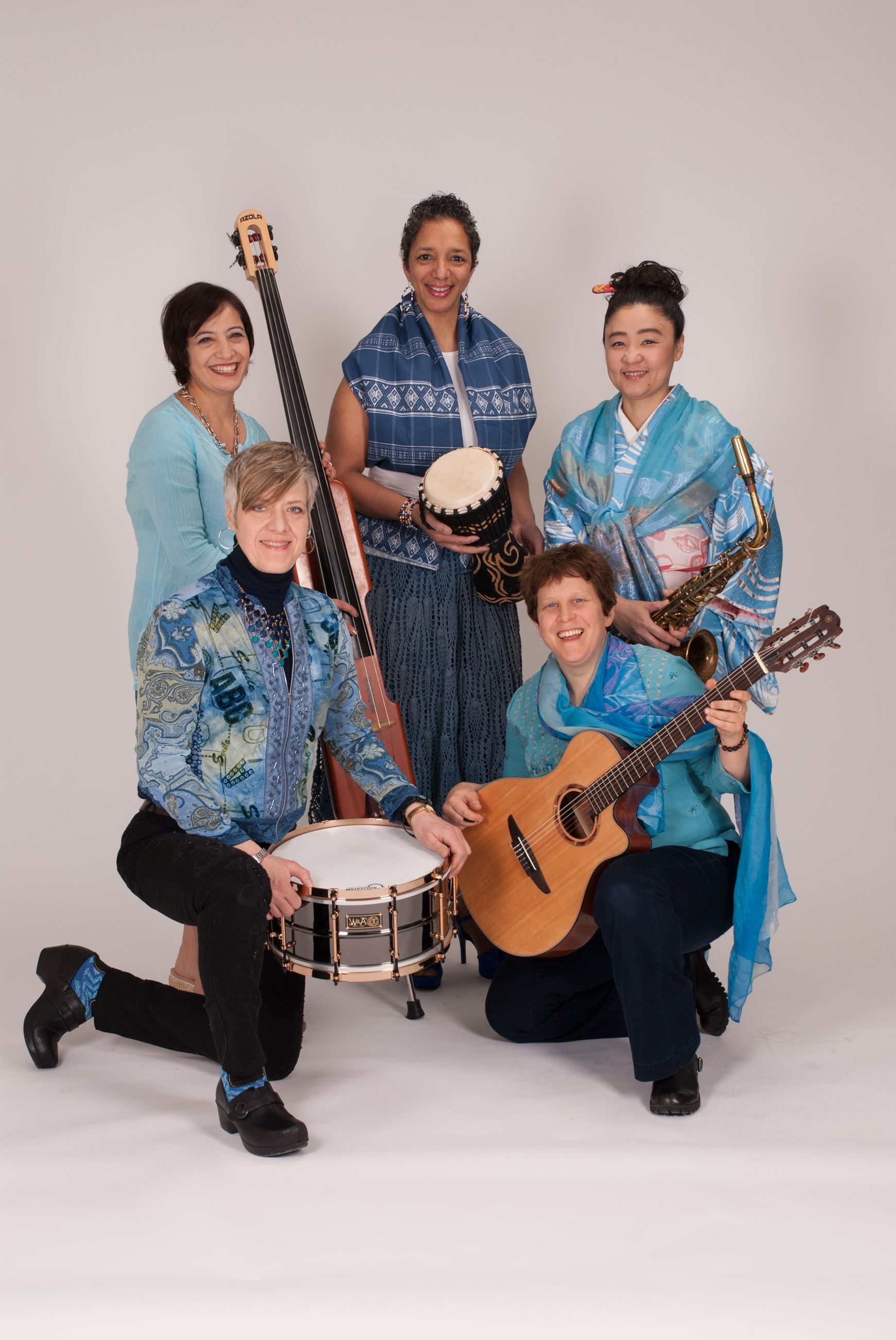 Image of women in blue holding instruments