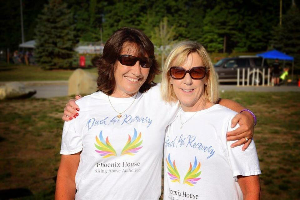 Image of two women wearing event shirts