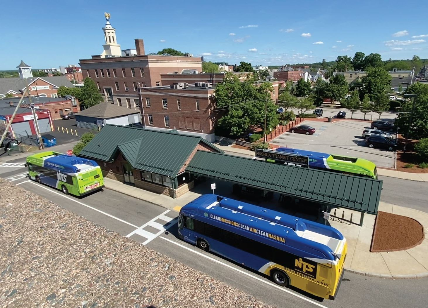 4 buses wait at NTS Transit Center