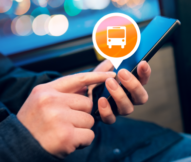 Passenger using Mobile Transit App on the Bus