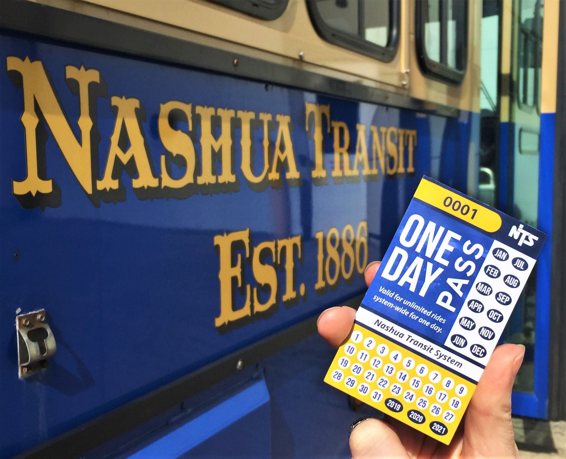 New Day Pass card in front of an NTS Trolley