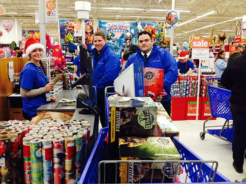 Volunteers buy Toys for Tots items