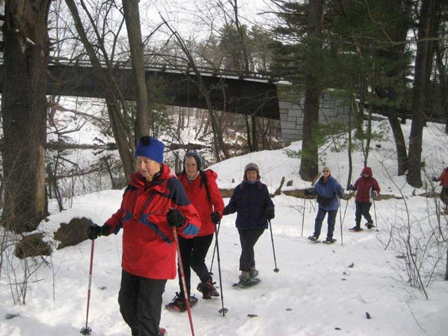 Group learning to walk in snowshoes.