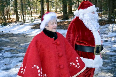 Santa and Mrs. Claus walking together.