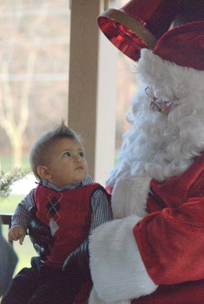 Santa holding a baby boy on his lap.