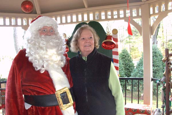 Woman standing with Santa Claus.
