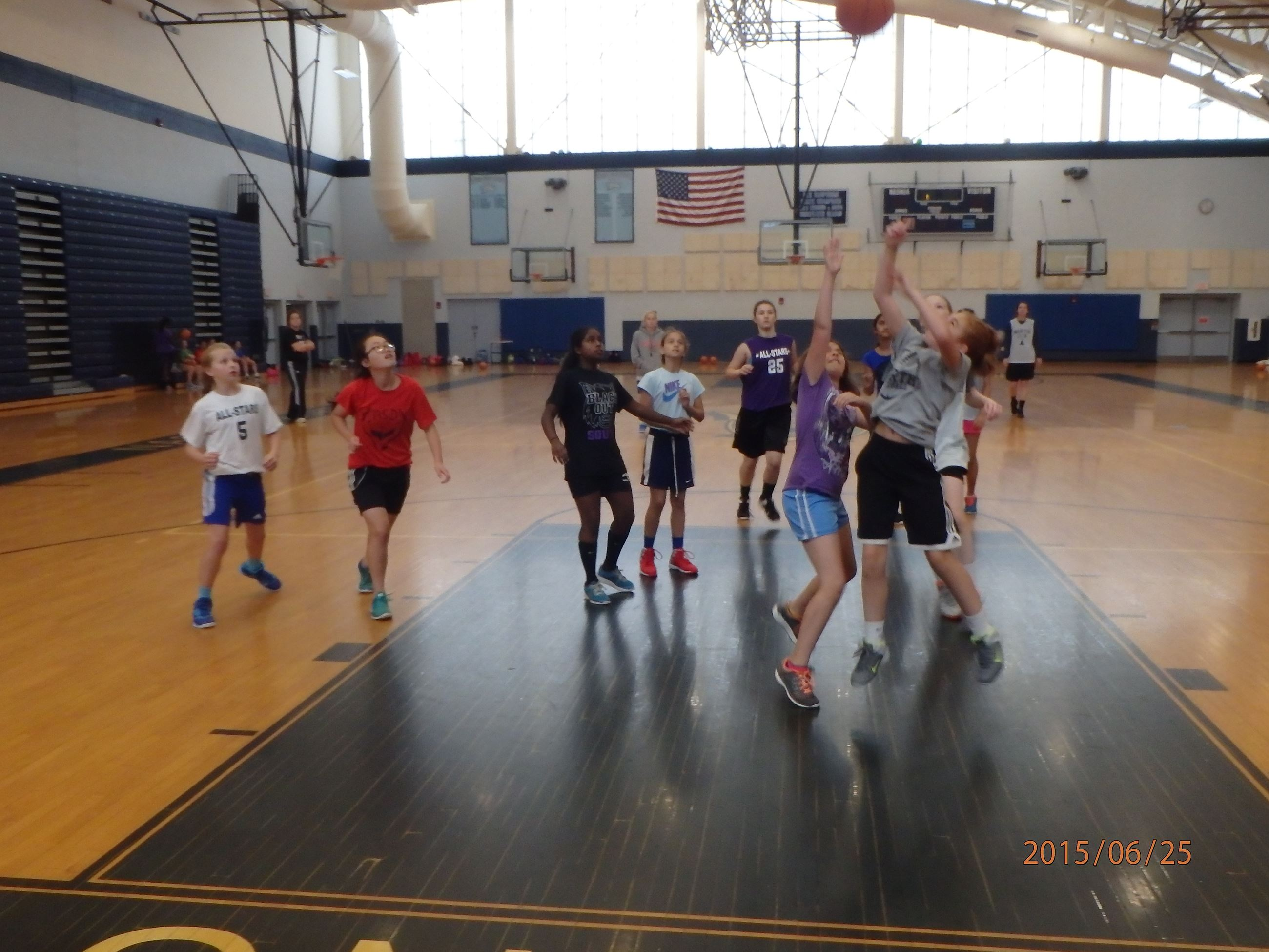 Girls Basketball Camp game shooting a basket.