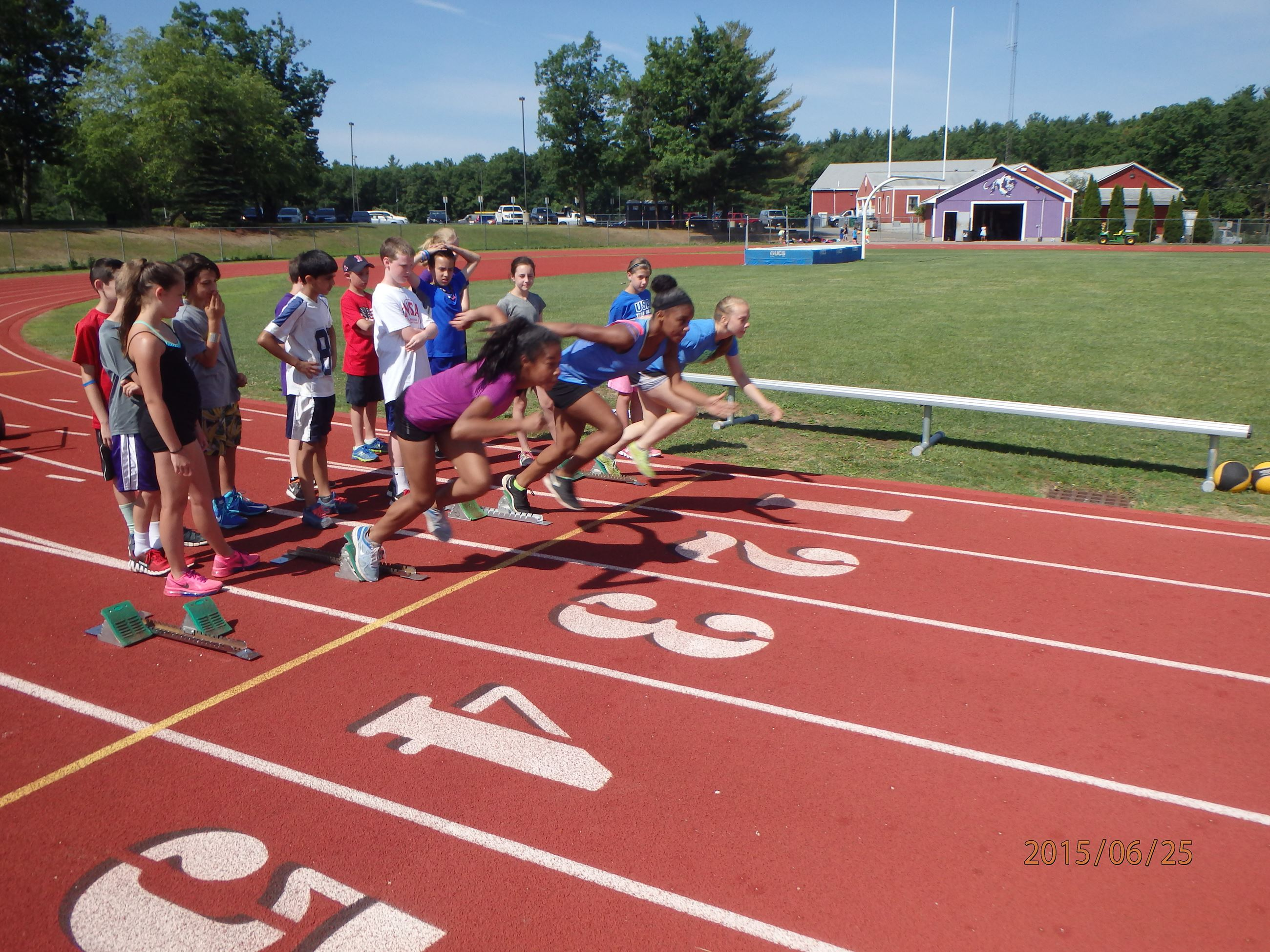 Track and Field Camp runners starting a race.