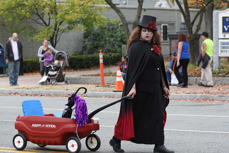 Women in Cape Pulling a Radio Flyer Wagon